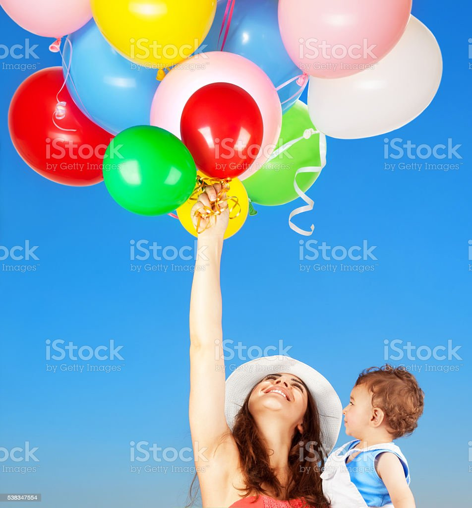 Mother with son playing outdoors stock photo