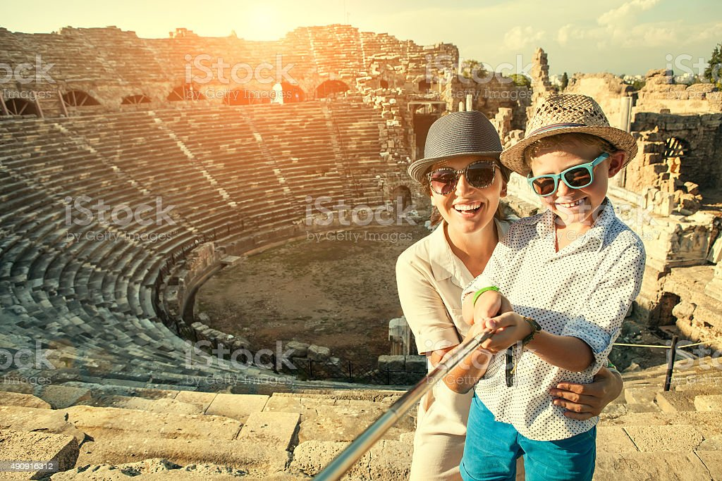 Mother with son take a selfie photo in antique theatre stock photo