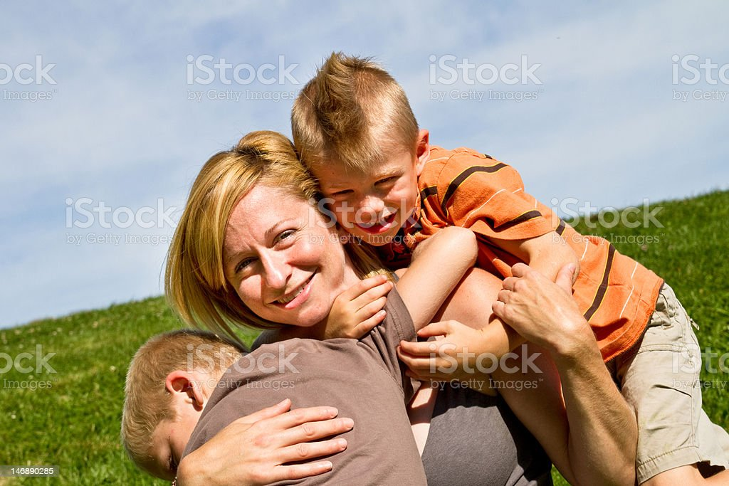 Mother with sons in the park royalty-free stock photo