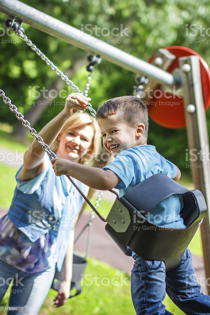 Mother with swinging son royalty-free stock photo