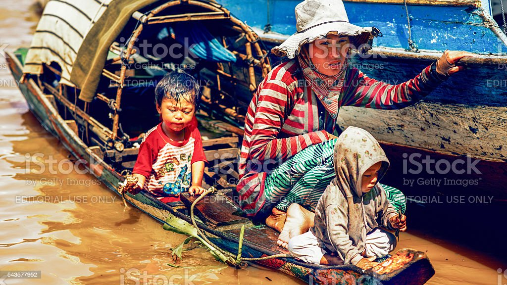 Mother with the children in the boat stock photo
