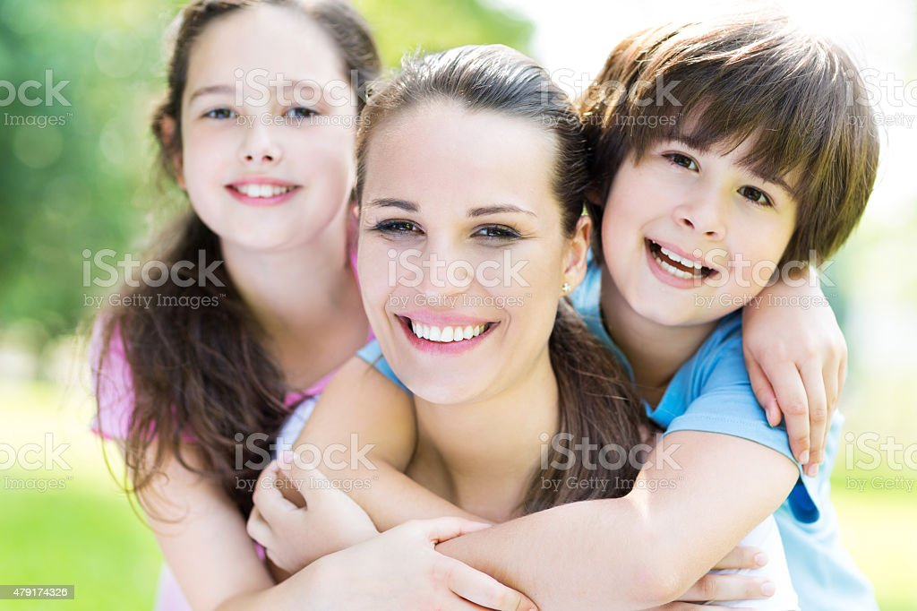 Mother with two children stock photo