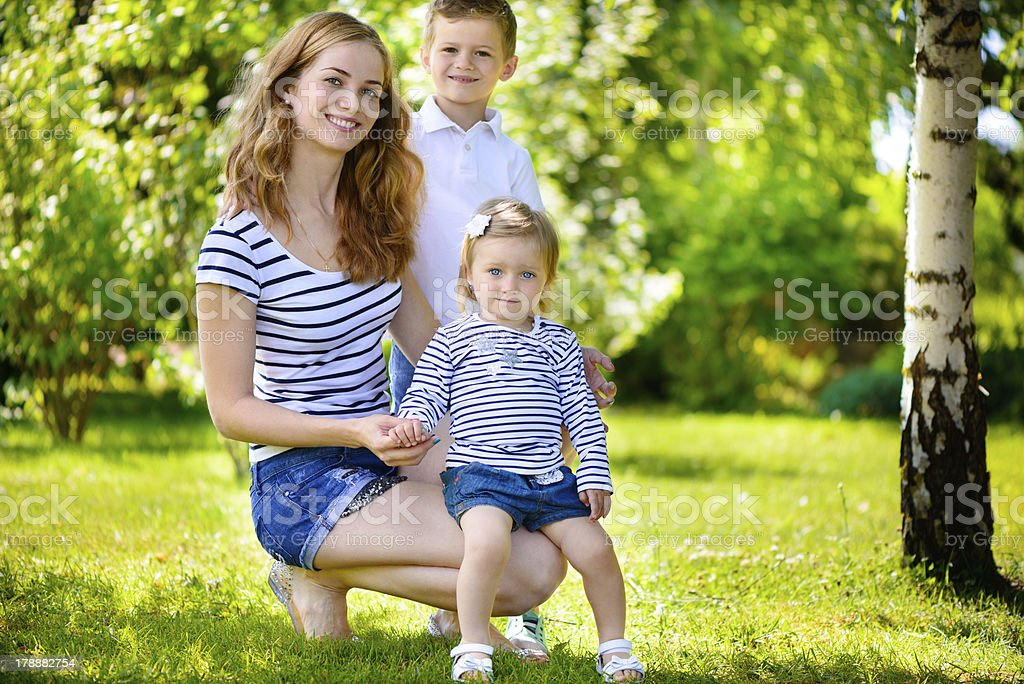 Mother with two children summer outdoors royalty-free stock photo