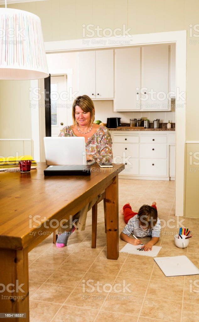 Mother working at home royalty-free stock photo