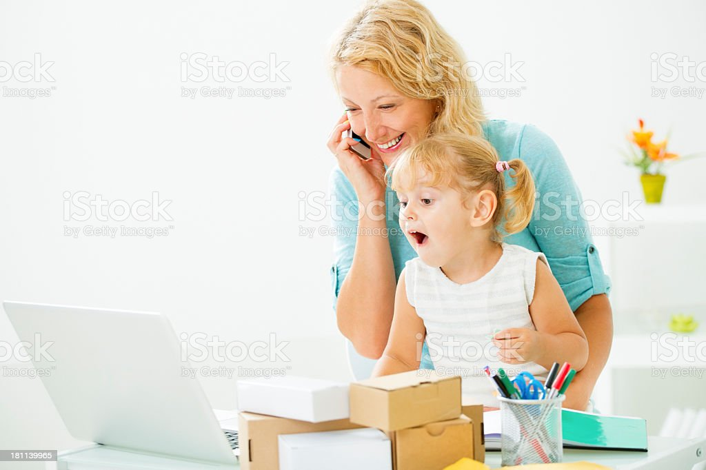Mother Working At Home with Child. royalty-free stock photo