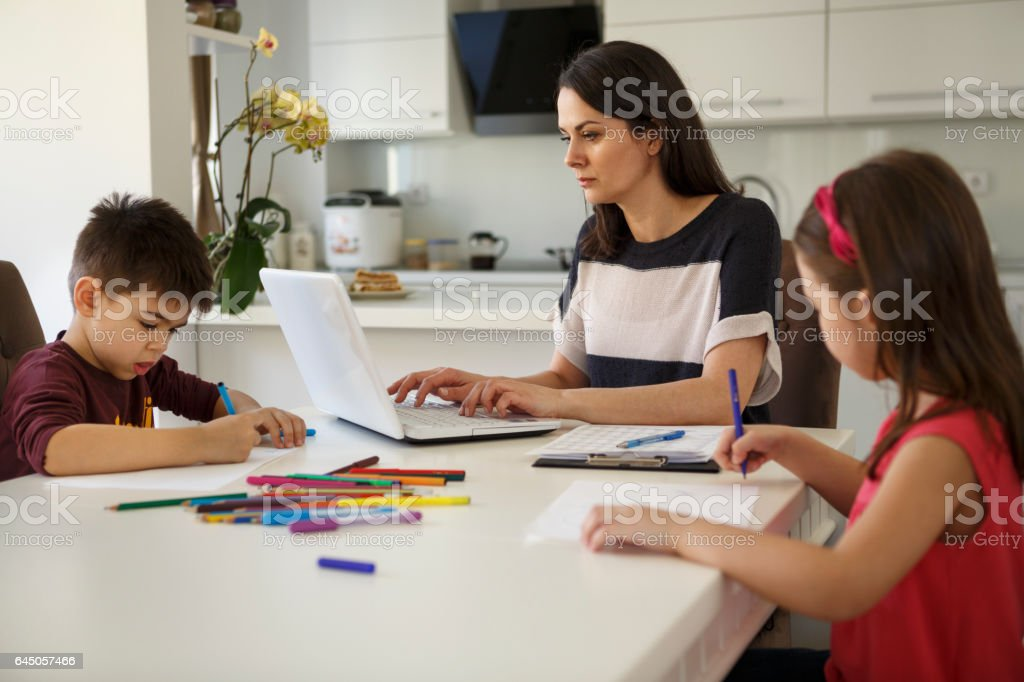 Mother working from home stock photo