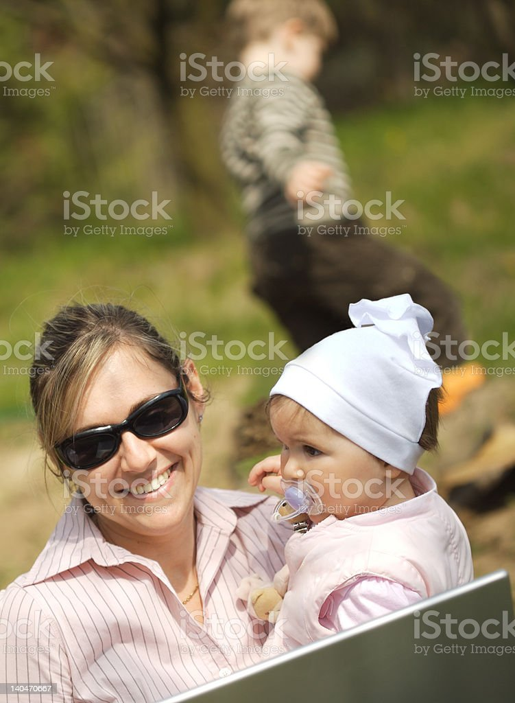 Mother works on laptop royalty-free stock photo