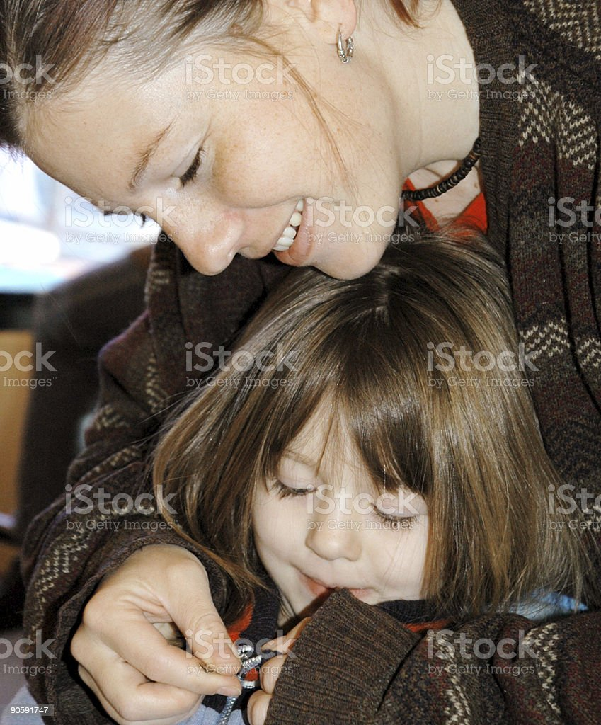 Mother Zipping Daughters Jacket royalty-free stock photo