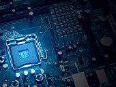 PC motherboard closeup, blue tone