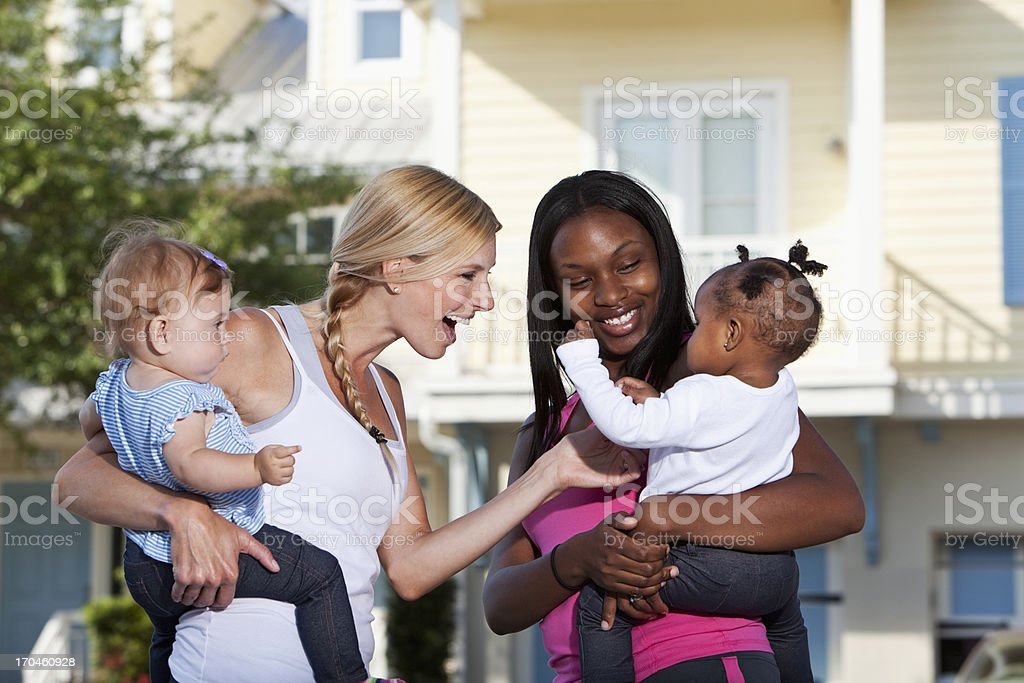 Mothers and babies laughing stock photo