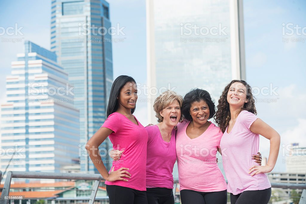 Mothers and daughters posing in city stock photo