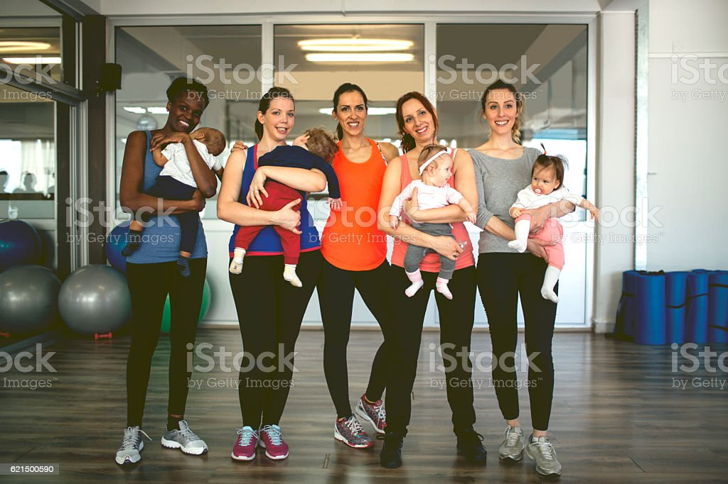 Mothers and their babies exercising stock photo