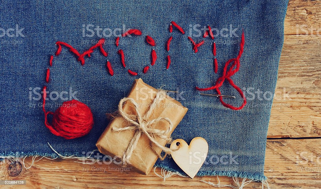 Mother's Day background, jeans, gift box stock photo