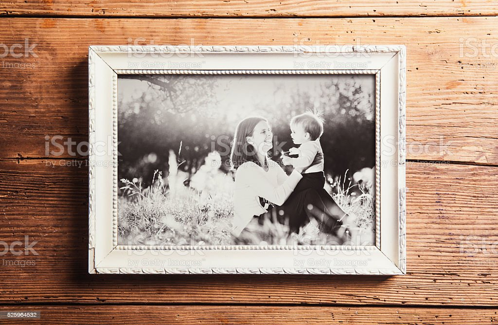 Mothers day composition. Picture frame. Wooden background. Studi stock photo