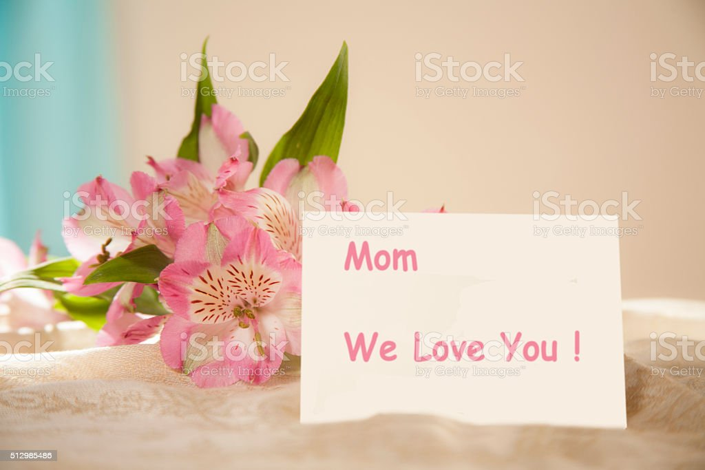 Mother's Day. Flower bouquet with notecard. 'We Love You' stock photo