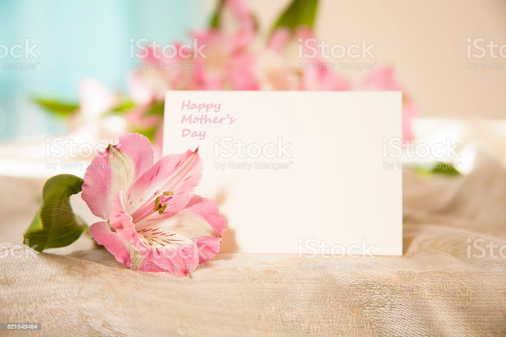 Mother's Day. Flower bouquet with white blank notecard. stock photo