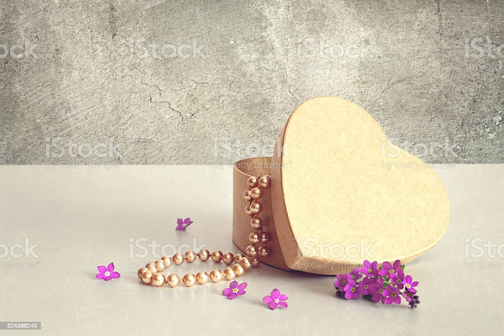 Mother's Day gift: Heart shaped gift box and pearls stock photo