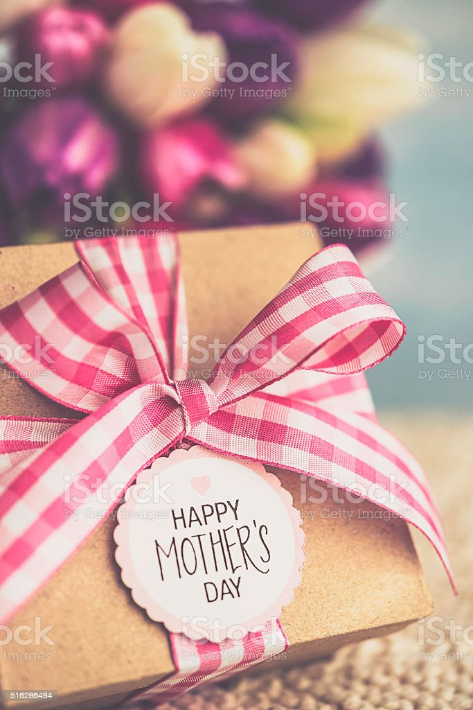 Mother's Day gift with bouquet of beautiful fresh tulips stock photo