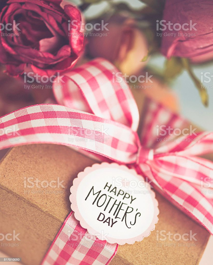 Mother's Day gift with bouquet of pink roses stock photo