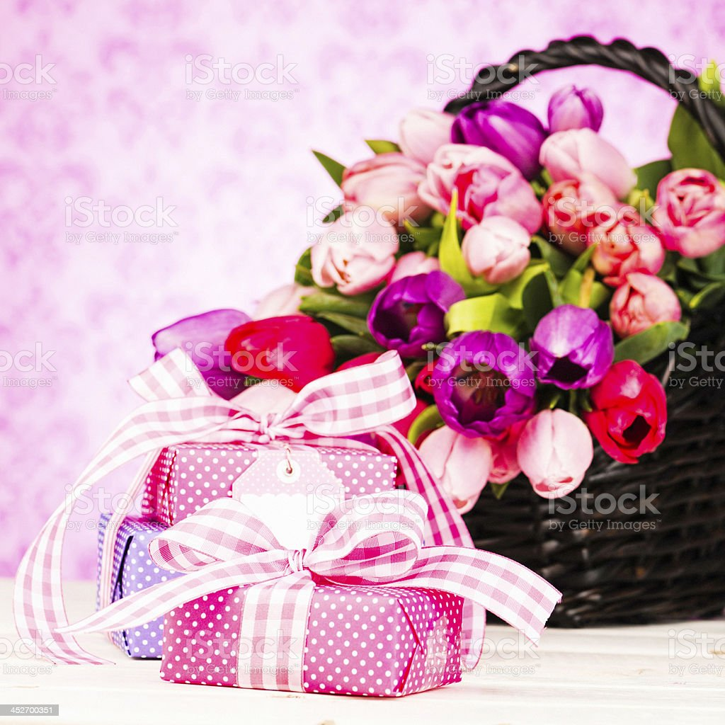 Mother's Day Gifts and Basket of Flowers royalty-free stock photo
