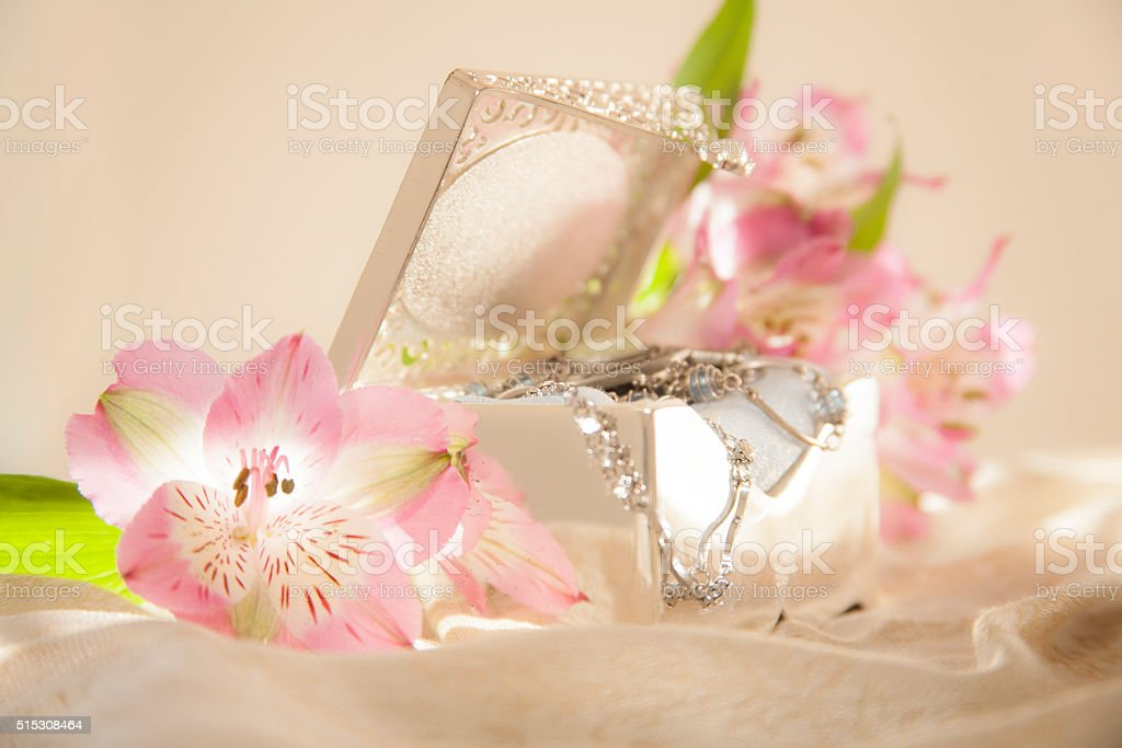 Mother's Day memories. Vintage silver jewelry box, flowers. stock photo