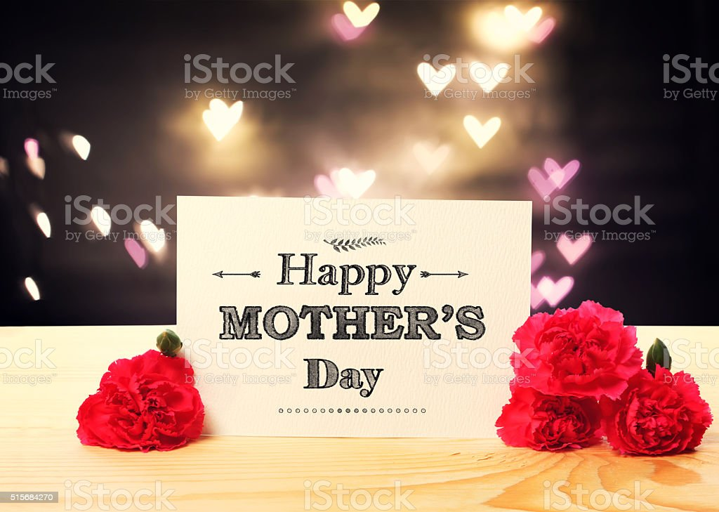 Mothers Day message card with carnation flowers stock photo