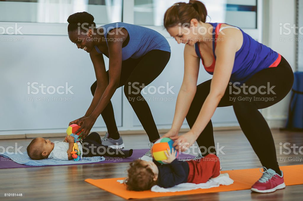 Mothers exercise with Their Babies. stock photo