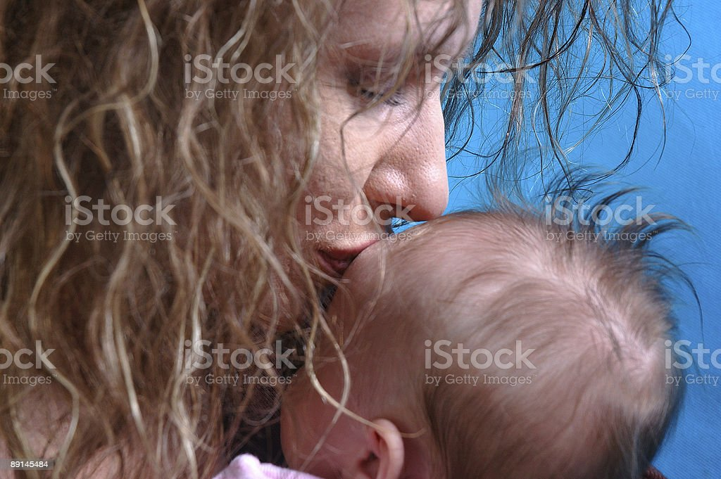 Mother's Kiss royalty-free stock photo