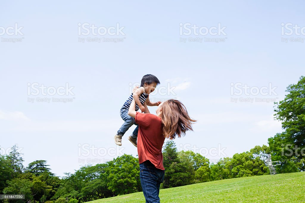 Mothers who are having children at a higher position stock photo