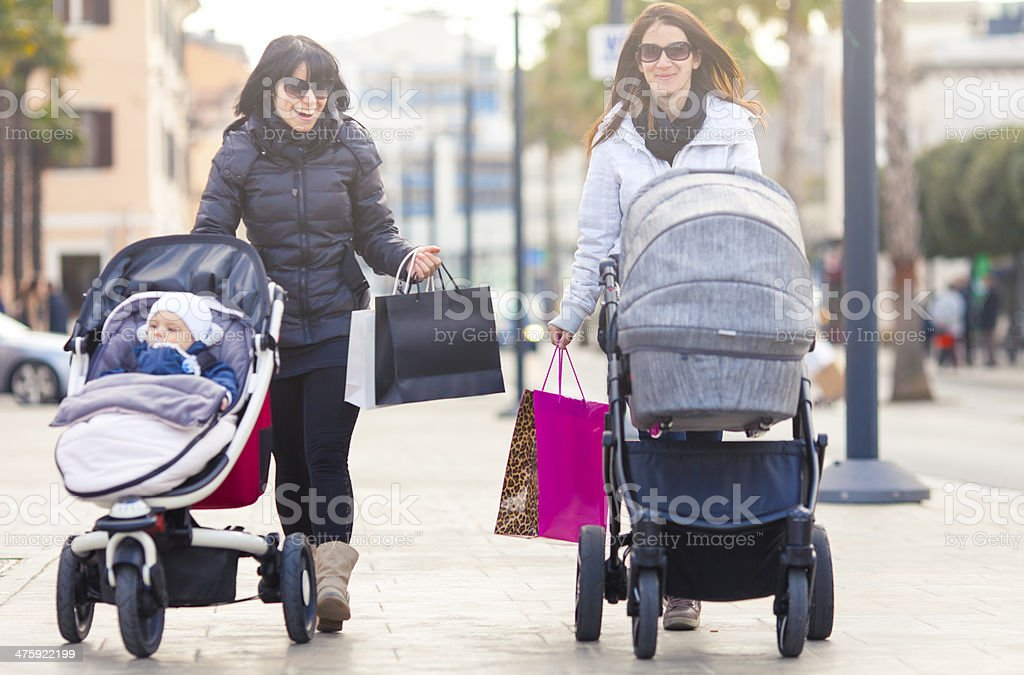 Mothers with strollers shopping in the city stock photo