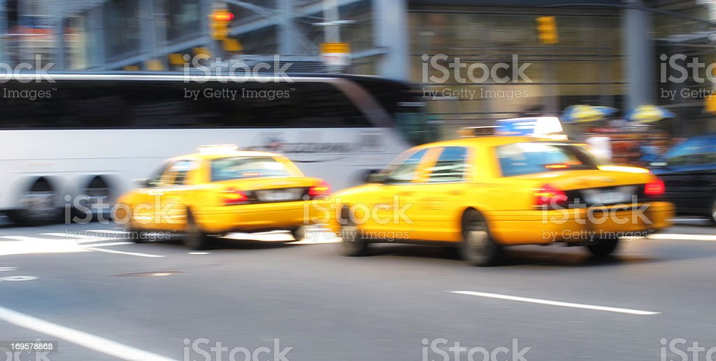 Motion and lens blurred taxi in New York stock photo