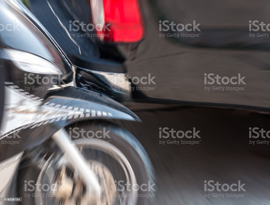 motion blur accident of motocycle collide with rear black pickup stock photo