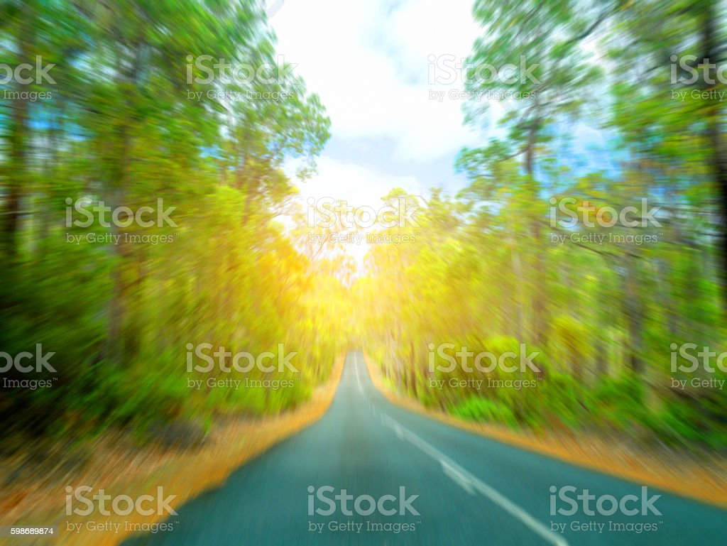 Motion blur beautiful road and trees with sunlight in evening stock photo