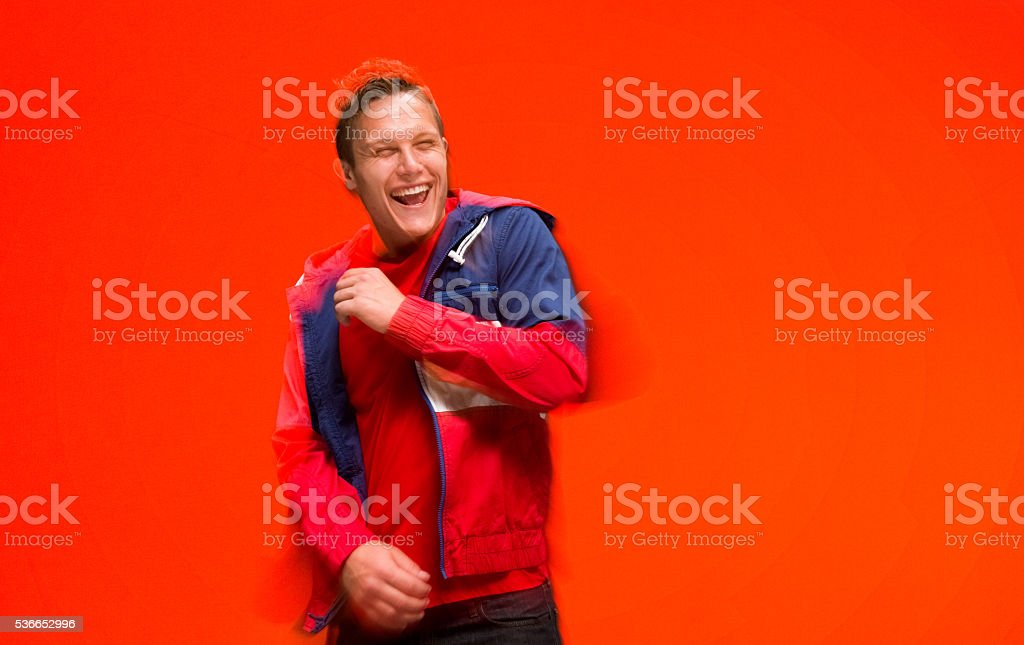 Motion blur - Casual man dancing stock photo