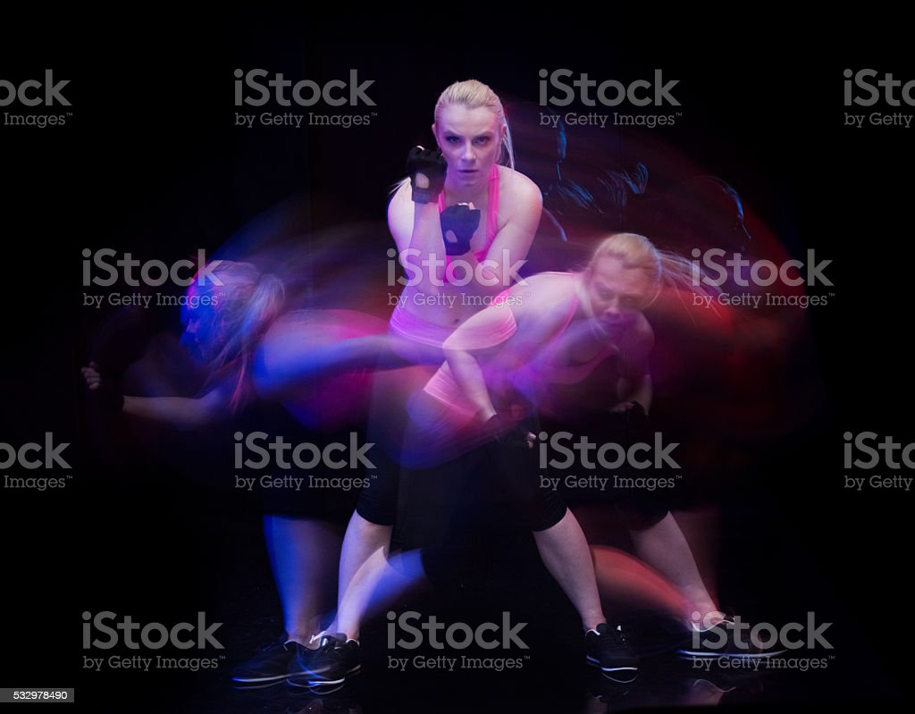 Motion blur - Casual woman fighting stock photo