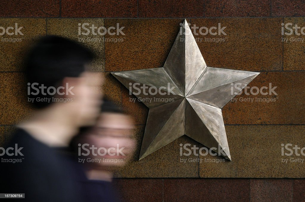 Motion Blur Couple Walk Past Star on Wall royalty-free stock photo
