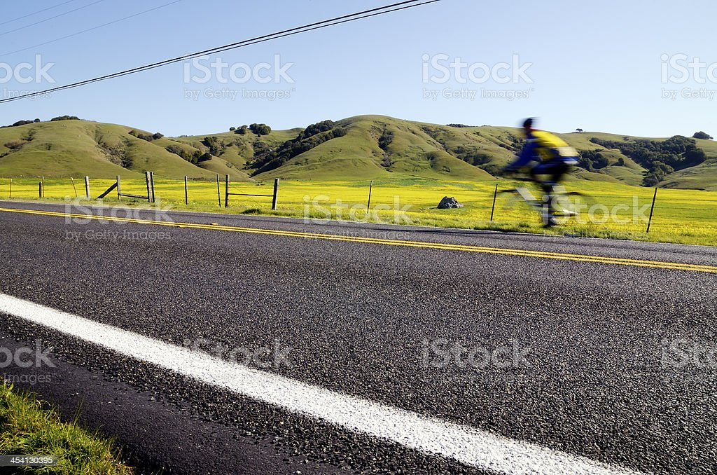 Motion blur cyclist royalty-free stock photo