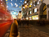 Motion blur of a London red bus on Oxford Street,