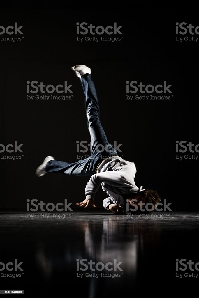 Motion Blur of Breakdancer, Low Key royalty-free stock photo