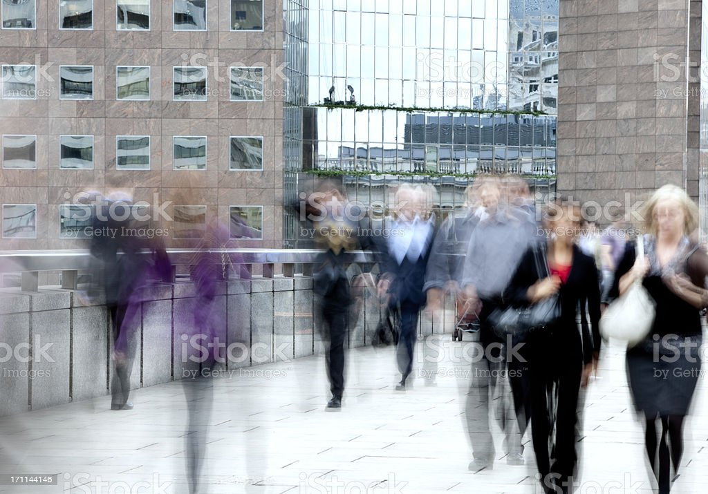 Motion blur of business people walking to work royalty-free stock photo