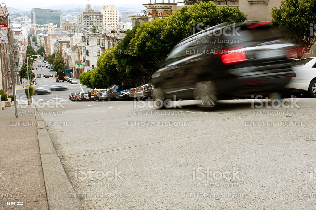 Motion Blur Of Car Braking On Steep San Francisco Street stock photo