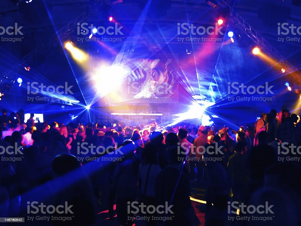 Motion Blur of dancing people in a disco stock photo