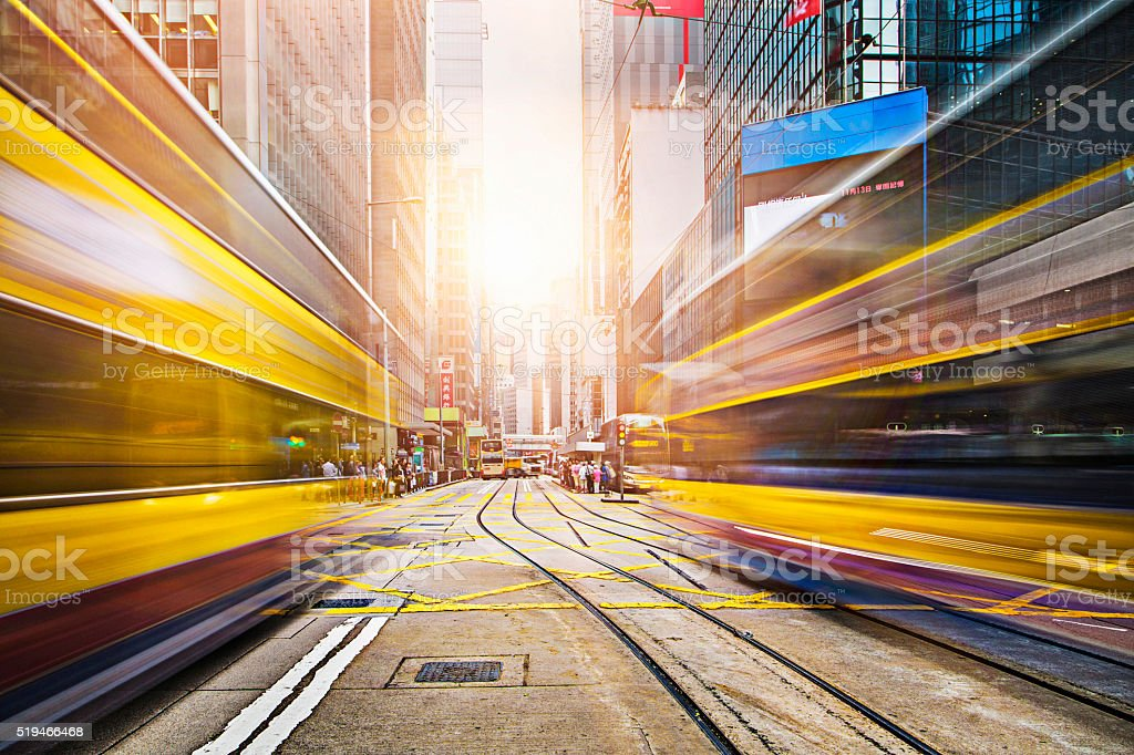 Motion blur of double decker buses in Hong Kong stock photo