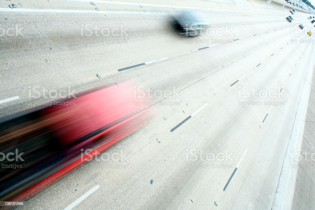 Motion Blur of Fast Cars on Highway stock photo