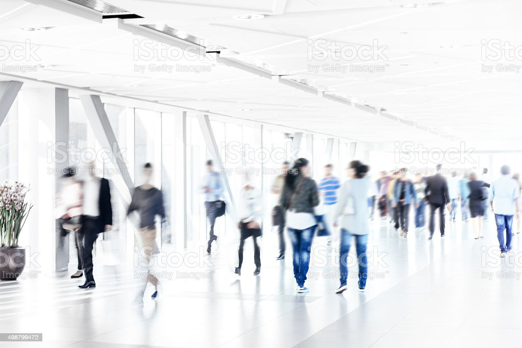 Motion Blur of People Walking in Corridor stock photo
