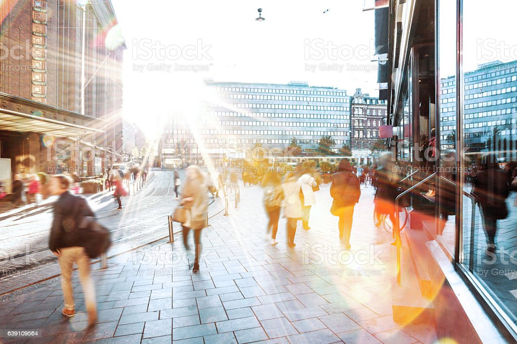 Motion Blur of People Walking in the City stock photo