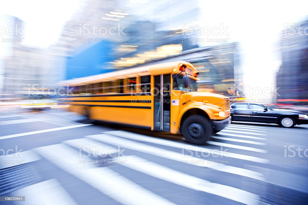 Motion Blur of School Bus in City royalty-free stock photo