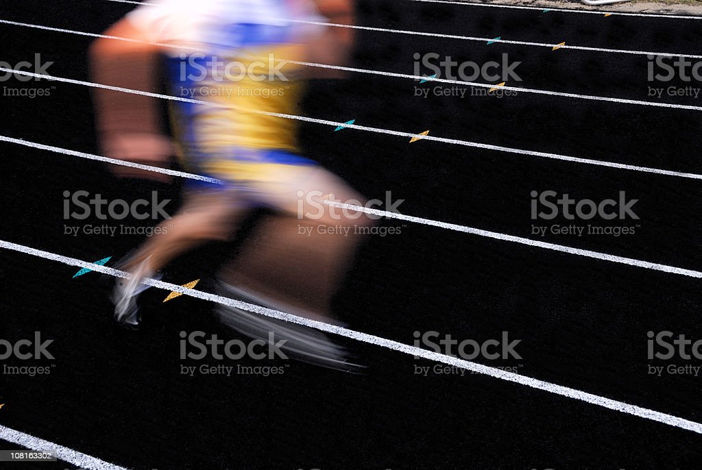 motion blur of sprinter on running track royalty-free stock photo