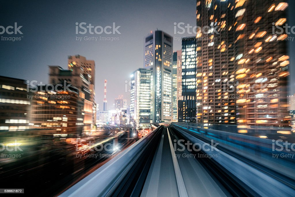 Motion blur of train moving to City stock photo