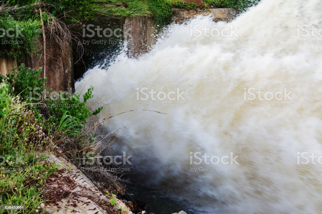 motion blur of waterfall from overflow of dam on rainy season, Nakhonsawan, Thailand stock photo